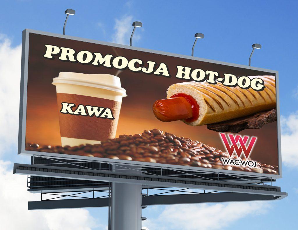 Billboard against blue cloudy sky